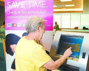 Lady using touch screen kiosk
